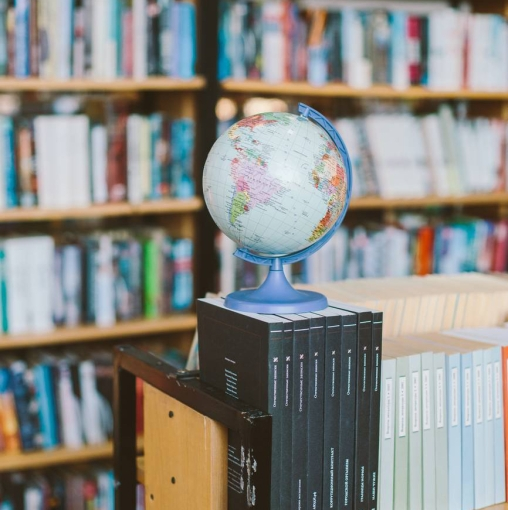 photo of globe on top of books